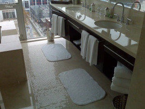 Hotel Ensuite Bathroom, Polished Marble Floor and Vanity - Scope of work: sand, polish and protect floor and vanity with a penetrating sealer.
