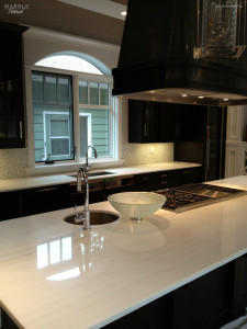 Residential Kitchen, Polished Marble Island and Counter Top - Scope of work: sand to remove existing damage, apply topical coating to protect marble from future etching and staining and polish coating to a high shine.