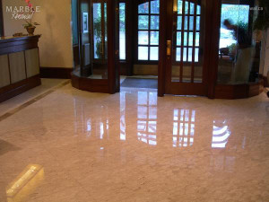 Condominium Lobby, Polished Marble Floor - Scope of work: sand, polish and protect floor with a penetrating sealer.